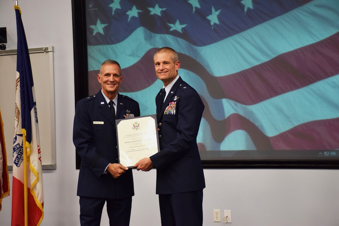 Brig. Gen. Shawn Ford (right), Deputy Adjutant General for Air, Iowa National Guard (IA ANG) presents Brig. Gen. Randy Greenwood (left), Chief of Staff, IA ANG, with his certificate of retirement at his retirement ceremony held in the Enhanced Classroom of Joint Force Headquarters in Johnston, Iowa on Saturday, October 5, 2019.  Greenwood is retiring after thirty-six years of service.  (U.S. Air National Guard photo by Tech. Sgt. Linda K. Burger/Released)