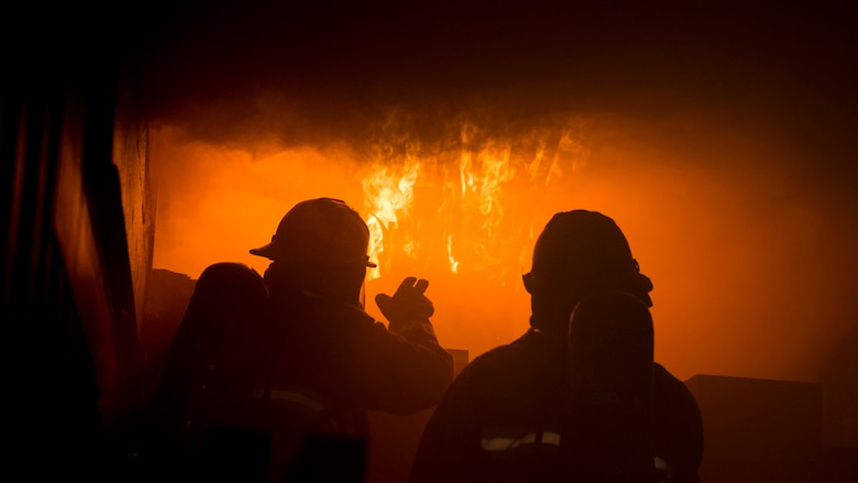 SSgt. Jack Simonds, a firefighter with the Gowen Field Fire Department, instructs a fellow Gowen Field firefighter on how to recognize the signs of flashover during a training in a specialized mobile burn trailer, Gowen Field, Boise, Idaho, Sept. 13, 2019.