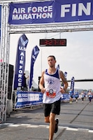 Arizona Air National Guard Master Sgt. Dan Martin, 161st Logistics Readiness Squadron NCO in charge of fuels, crosses the finish line of the Air Force Marathon Sept. 21, 2019. Martin finished the 23rd annual Air Force Marathon with a time of 3:27:07 and placed 49th overall as well as a Major Command team win with the Air National Guard team.