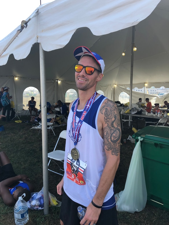 Arizona Air National Guard Master Sgt. Dan Martin, 161st Logistics Readiness Squadron NCO in charge of fuels, poses for a photo with his finisher medal after completing the Air Force Marathon Sept. 21, 2019. Martin finished the 23rd annual Air Force Marathon with a time of 3:27:07 and placed 49th overall as well as a Major Command team win with the Air National Guard team.
