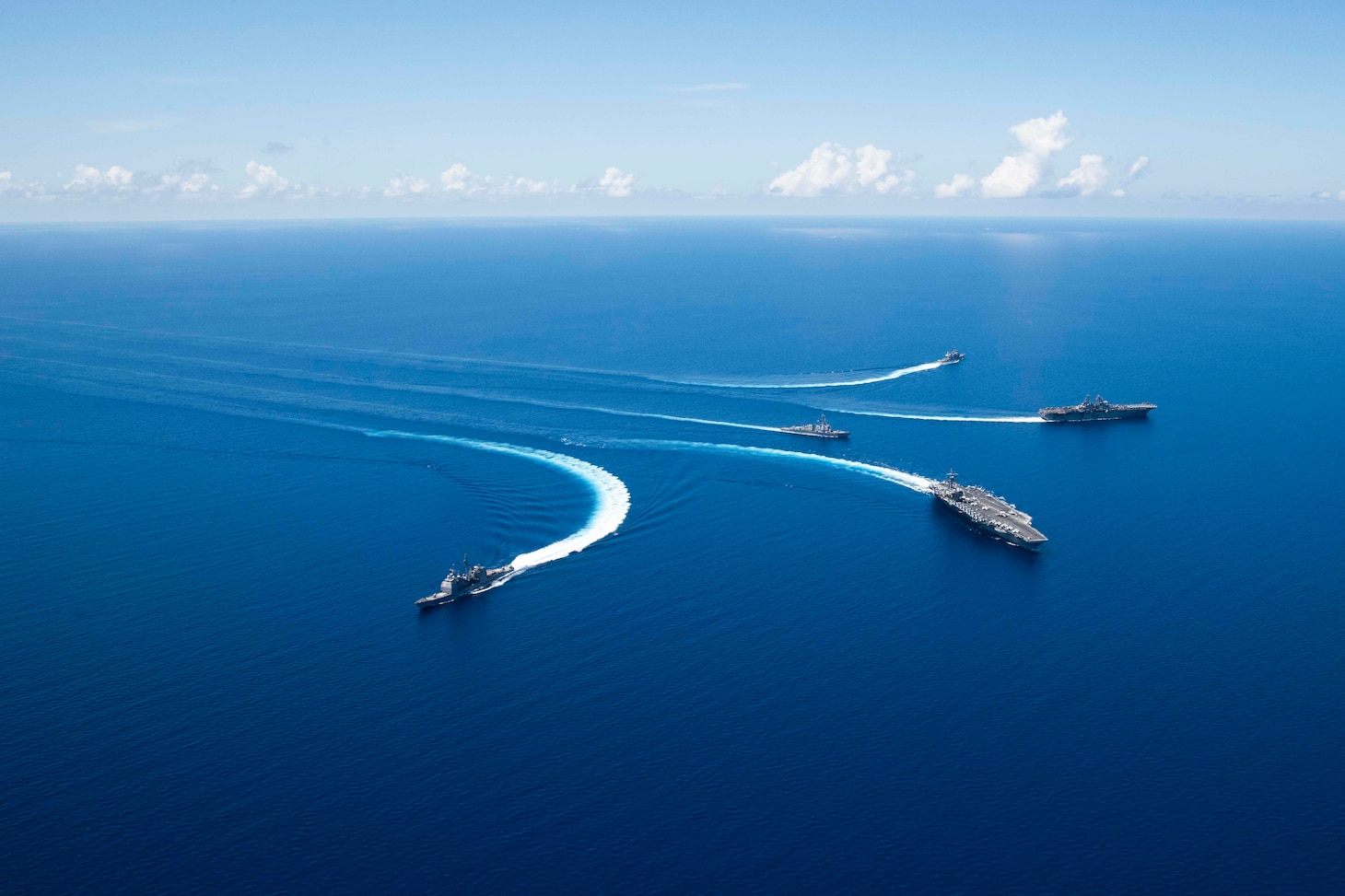 191006-N-VI515-0567 SOUTH CHINA SEA (October 6, 2019) Ships from Ronald Reagan Carrier Strike Group and Boxer Amphibious Ready Group conduct breakaway maneuvers while sailing in formation during security and stability operations in the U.S. 7th Fleet area of operations. U.S. 7th Fleet is the largest numbered fleet in the world, and the U.S. Navy has operated in the Indo-Pacific region for more than 70 years, providing credible, ready forces to help preserve peace and prevent conflict.