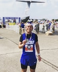 U.S. Air Force Staff Sgt. Daniel Ly, 8th Force Support Squadron customer support noncommissioned officer in charge, poses with his medal after completing the Air Force Marathon at Wright-Patterson Air Force Base, Ohio, Sept. 21, 2019. Ly has been running since 8th grade and has competed in 17 full marathon races. (Courtesy photo)