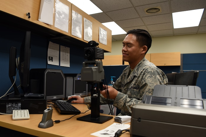 U.S. Air Force Staff Sgt. Daniel Ly, 8th Force Support Squadron customer support noncommissioned officer in charge, adjust a camera on his desk at Kunsan Air Base, Republic of Korea, Oct. 1, 2019. When Ly is not assisting customers with getting new common access cards and enrolling in the Korea Area Incentive Program, he likes to run to relieve his stress and stay in shape. (U.S. Air Force photo by Staff Sgt. Joshua Edwards)