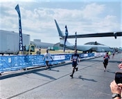 U.S. Air Force Staff Sgt. Daniel Ly, 8th Force Support Squadron customer support noncommissioned officer in charge, run during the Air Force Marathon at Wright-Patterson Air Force Base, Ohio, Sept. 21, 2019. Ly ran on behalf of the U.S. Pacific Air Forces team and was only one of four selected to run the full marathon. (Courtesy photo)