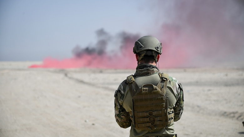 U.S. Air Force Staff Sgt. Frank Lopez, 386th Expeditionary Civil Engineer Squadron explosive ordnance disposal journeyman, assigned to Ali Al Salem Air Base, watches a blast during a rapid airfield damage repair exercise at Udari Range, Kuwait, Sept. 25, 2019. EOD technicians train to detect, disarm, detonate and dispose of explosive threats all over the world.