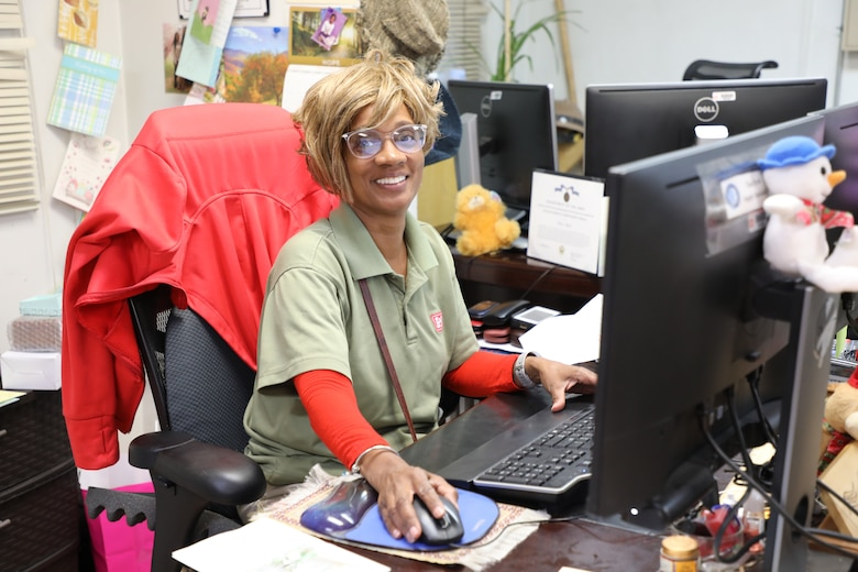 Logistics Specialist Tina Byrd at her desk on Bagram Airfield, Afghanistan. Byrd was recently awarded the Department of the Army Civilian Service Achievement Medal both for her work supporting Operation Freedom's Sentinel since arriving in Afghanistan in October 2018 and for going above and beyond the scope of her duties to establish an effective and sustainable requisitioning process for the district.