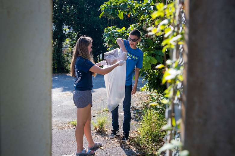 U.S. Navy Hospitalman Apprentice Lynsey Gabrielson, left, and Hospitalman Nathaniel Lovato pick up trash during the monthly Friendship Cleanup Uruma City, Okinawa, Japan on Oct. 5, 2019. Gabrielson and Lavato are dental technicians with 3rd Dental Battalion, and are from Downers Grove, Ill., and Vail, Ariz. respectively. The Single Marine Program coordinates the cleanup every month to provide service members the opportunity to volunteer for community service and build friendly relationships with the local community.
