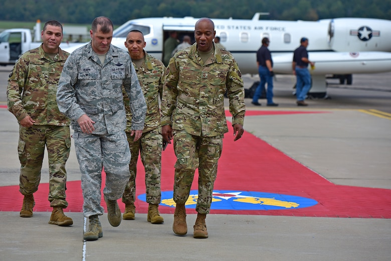 Airman arrive to base stepping off plane