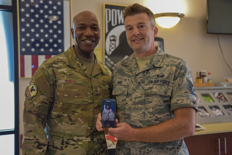 An Airman poses for a photo with Chief Wright