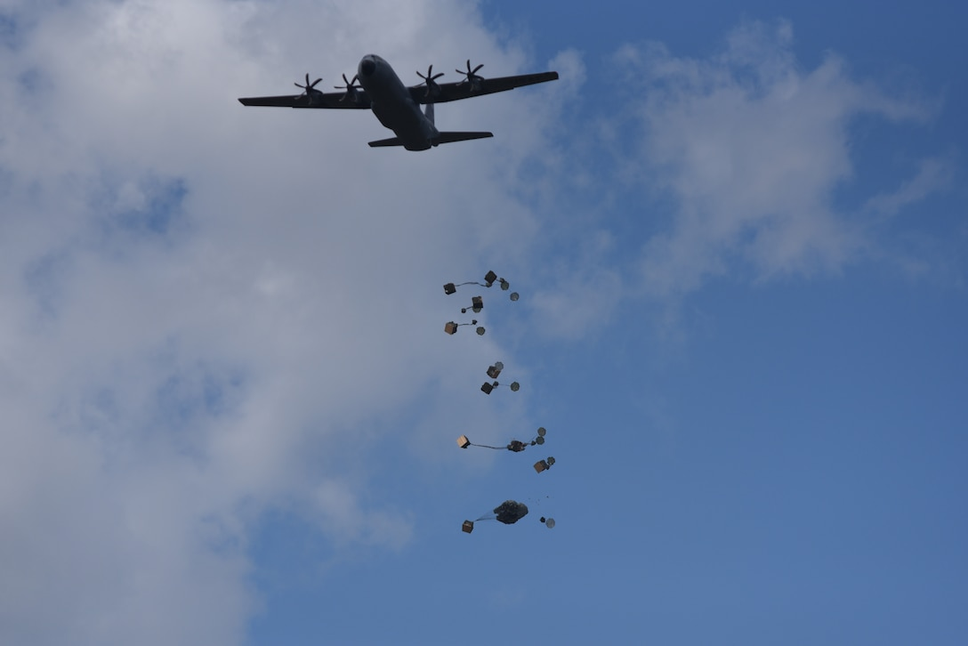 The 815th Airlift Squadron completes an airdrop of container delivery systems during the Army's joint forces exercise Arctic Anvil, Oct. 1-6, over Camp Shelby Joint Forces Training Center, Miss. Reserve Citizen Airmen from the 815th AS assigned to the 403rd Wing at Keesler Air Force Base, Miss., and the 327th AS assigned to the 913th Airlift Group at Little Rock AFB, Ark., provided airlift and airdrop capabilities to the 4th Brigade Combat Team (Airborne), 25th Infantry Division stationed at Joint Base Elmendorf-Richardson, Alaska. (U.S. Air Force photo by Master Sgt. Jessica L. Kendziorek)