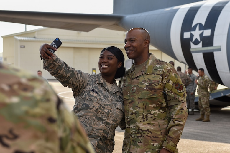 An Airman takes a selfie with Chief Wright