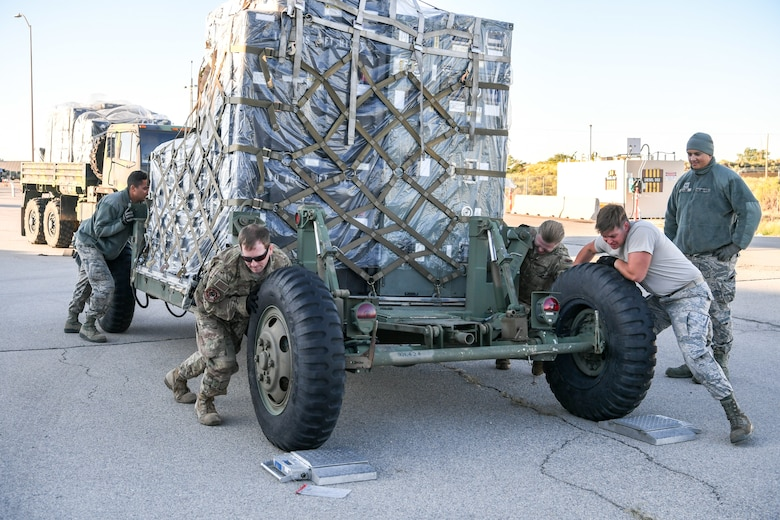 Airmen from 729th Air Control Squadron push a vehicle to be weighed at Hill Air Force Base, Utah, Sept. 13, 2019. The Airmen were preparing to deploy to Wendover Field, Utah, to participate in the squadron's annual Raging Bull exercise. (U.S. Air Force photo by Cynthia Griggs)