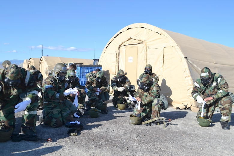 Airmen from 729th Air Control Squadron during a chemical, biological, radiological, and nuclear exercise Sept. 21, 2019 at a base camp at Wendover Field, Utah. The Airmen were participating in the squadron's annual Raging Bull exercise, where they set up a remote radar site to extend the unit's capability to control aircraft. (Courtesy photo by Master Sgt. Daniel Lane)