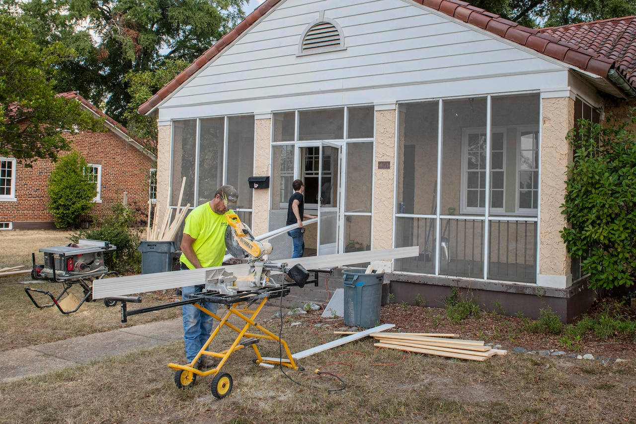 Workers install new windows at a historic home.
