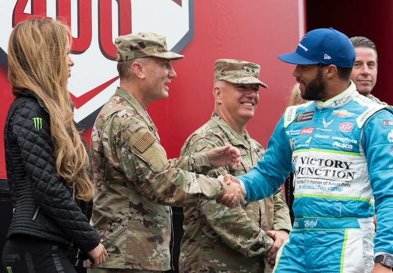 "Maj. Gen. Clinton Crosier, assigned to the Deputy Chief of Staff for Strategy, Integration and Requirements, Headquarters U.S. Air Force, Arlington, Va., shakes hands with Bubba Wallace, driver of the No. 43 Victory Junction Chevrolet during driver introductions Oct. 6, 2019, at Dover International Speedway, Dover, Del. The U.S. Air Force is one of many sponsors of the No. 43 car that started in the 26th position for the ""Drydene 400"" Monster Energy NASCAR Cup Series playoff race. (U.S. Air Force photo by Roland Balik)"