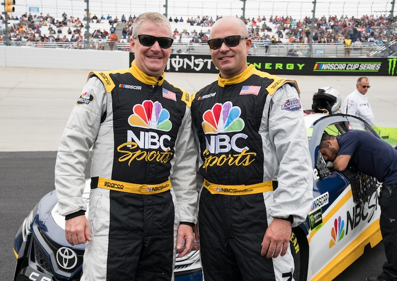 "Jeff Burton, left, NBC Sports Group's NASCAR Cup analyst, and Master Sgt. Chad Huggins, 436th Aerial Port Squadron combat readiness and resources section chief, pose for a photo Oct. 6, 2019, at Dover International Speedway, Dover, Del. Burton took Huggins for a ""joy ride"" in the NBC car at full speed around the Monster Mile, which was broadcasted live prior to the start of the ""Drydene 400"" Monster Energy NASCAR Cup Series playoff race. (U.S. Air Force photo by Roland Balik)"