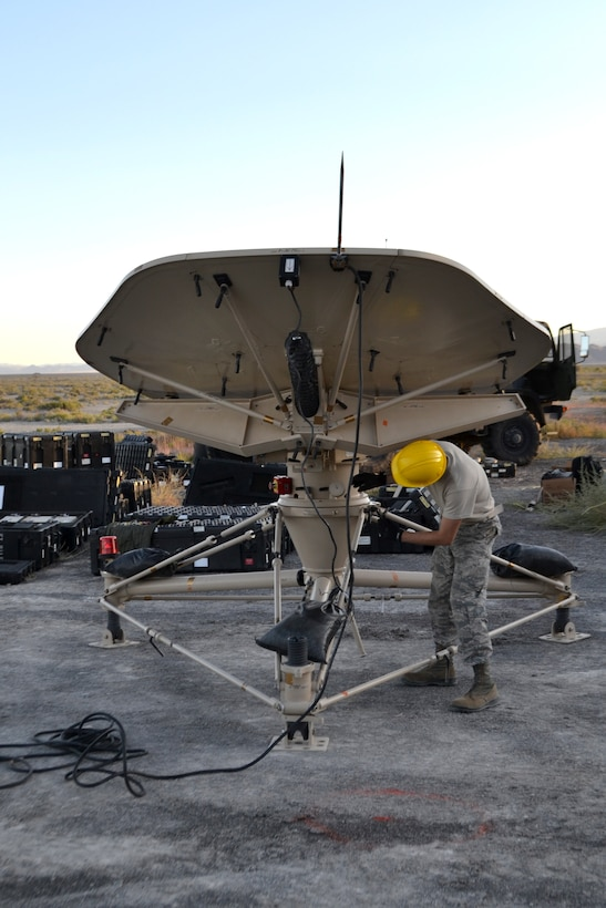Airman 1st Class Jake Sevier, 729th Air Control Squadron, sets up a small aperture antenna at a base camp at Wendover Field, Utah. The Airmen were participating in the squadron's annual Raging Bull exercise, where they set up a remote radar site to extend the unit's capability to control aircraft. (Courtesy photo by Master Sgt. Daniel Lane)