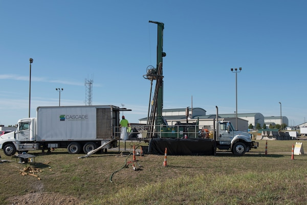 Cascade Drilling, LLC, uses a sonic rig to drill a monitoring well at the 167th Airlift Wing, West Virginia Air National Guard, Sept. 25, 2019.  The drilling is part of an expanded site investigation for per- and polyfluoroalkyl substances (PFAS) in and around the Martinsburg, W.Va. air base. The 167th AW's use of aqueous film forming foam, AFFF, for fighting petroleum fires, contained PFAS, and is thought to have migrated to the Big Springs Deep Well which provides water for the City of Martinsburg. The Environmental Protection Agency issued a drinking water advisory for PFOA and PFOS in 2016. (U.S. Air National Guard photo by Senior Master Sg. Emily Beightol-Deyerle)