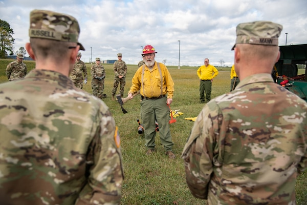 Members of the West Virginia Army National Guard's 249th Army Band participate in basic wildland fire suppression training, conducted by the West Virginia Division of Forestry in Morgantown, West Virginia, Oct. 3, 2019. The training covered basic wildland fire fighting techniques including understanding fire behavior, suppression tactics and techniques, crew organization, communications, and crew safety and awareness, with the goal of providing WNVG Soldiers the basic skills and experience to operate on a fire line side-by-side with experienced Division of Forestry personnel. (U.S. Army National Guard photo by Edwin L. Wriston)