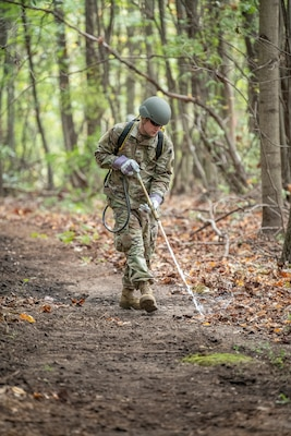 A soldier of the West Virginia Army National Guard's 249th Army Band sprays a defensive fire break barrier mixture from a backpack unit during basic wildland fire suppression training, conducted by the West Virginia Division of Forestry in Morgantown, West Virginia, Oct. 3, 2019. The training covered basic wildland fire fighting techniques including understanding fire behavior, suppression tactics and techniques, crew organization, communications, and crew safety and awareness, with the goal of providing WNVG Soldiers the basic skills and experience to operate on a fire line side-by-side with experienced Division of Forestry personnel. (U.S. Army National Guard photo by Edwin L. Wriston)