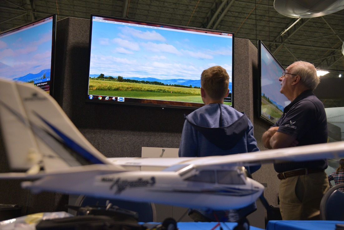 A student using a flight simulator.