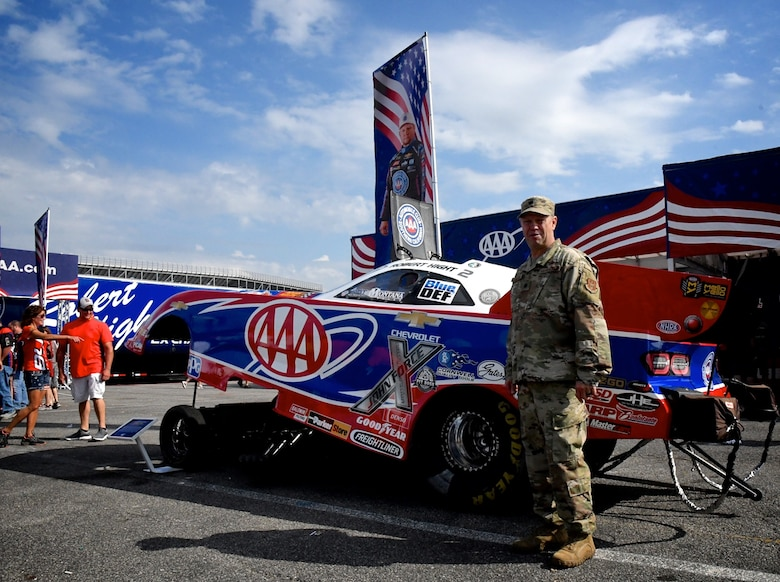 """The National Hot Rod Association held their Midwest Nationals at the World Wide Technology Raceway at Gateway Motorsports, Madison Illinois, with Lt. Col. William McLeod, 932nd Maintenance Group commander, invited to help start the event as an honored guest, Sept. 29, 2019.  McLeod was brought on stage during the opening ceremony and presented an NHRA challenge coin and waved to the cheering crowd.  The 932nd Airlift Wing is known as """"the Gateway Wing"""" in the Air Force Reserve Command and flies four C-40 aircraft around the world for distinguished visitor airlift.  (U.S. Air Force photo by Lt. Col. Stan Paregien)"""