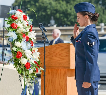 A U.S. Air Force Airman with the Twenty-Fifth Air Force salutes a wreath laid in tribute during the annual headquarters remembrance ceremony at Joint Base San Antonio-Lackland Oct. 4. More than 5,600 of the community's brothers and sisters have perished, and the names of more than 130 of the most recent losses were read during the ceremony.