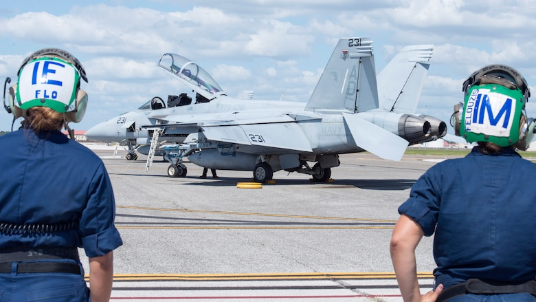 Petty Officer 2nd Class Michelle Flores, a Strike Fighter Squadron (VFA) 106 aviation electrician, and Petty Officer 2nd Class Erika Felouzis, a VFA-106 aviation mechanic from Naval Air Station Oceania, Va., monitor the flight line at MacDill Air Force Base, Fla., Oct. 3, 2019.