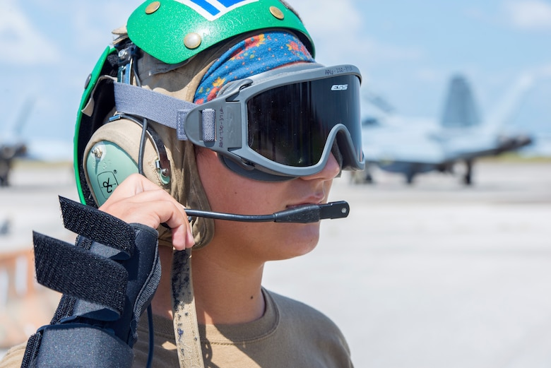 Petty Officer 3rd Class Sylvia Gonzalez, a Strike Fighter Squadron 106 aviation mechanic from Naval Air Station Oceania, Va., communicates with a fellow Sailor at MacDill Air Force Base, Fla., Oct. 1, 2019.