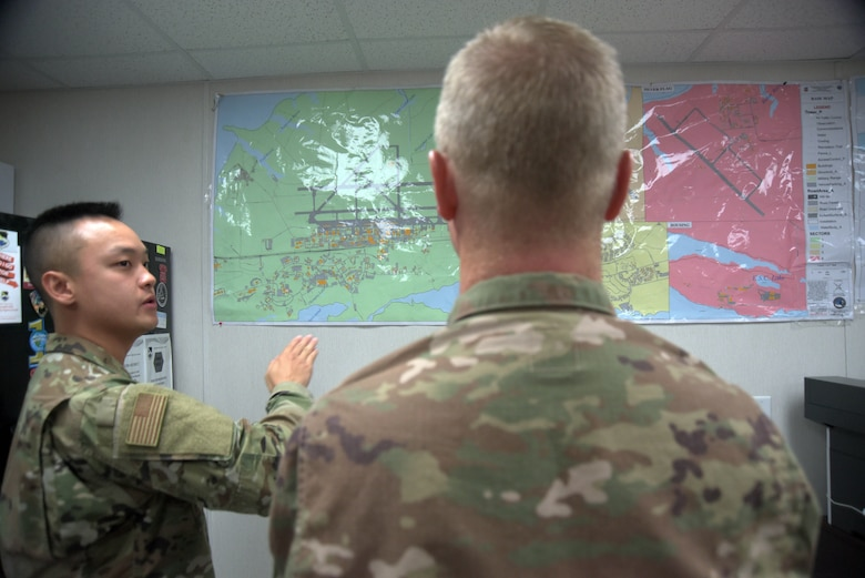 Airman 1st Class Brian Nguyen, 325th Operational Medical Readiness Squadron Ambulance Services Department medic, left, briefs Col. Brian Laidlaw, 325th Fighter Wing commander, right, on Oct. 4, 2019, at Tyndall Air Force Base, Florida. Several maps depict the designated area of responsibility the 325th OMRS ASD has both inside and outside of the installation's borders. (U.S. Air Force photo by Staff Sgt. Magen M. Reeves)