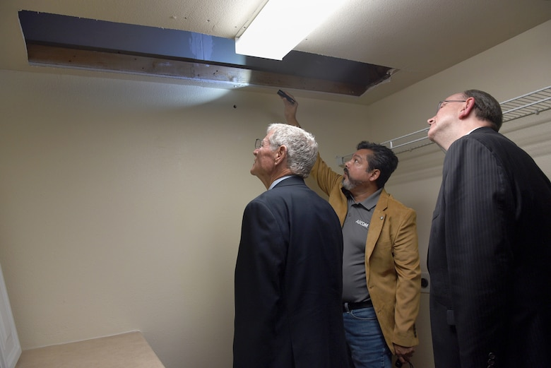 An image of Congressional and Air Force leaders reviewing the housing situation on Tinker Air Force Base.