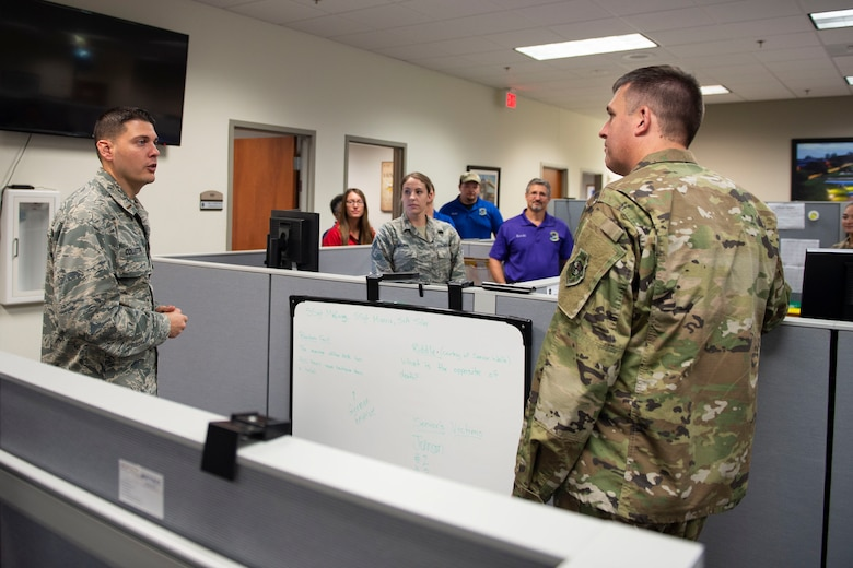 Col. Daniel Walls, 23d Wing commander, visits the Finance Customer Service office Oct. 7, 2019, at Moody Air Force Base, Ga. Walls toured different components of Moody's Wing Staff Agency to acknowledge their contributions to the mission. (U.S. Air Force photo by Airman Azaria E. Foster)