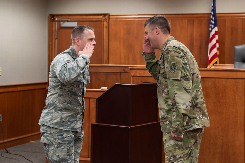 Col. Daniel Walls, right, 23d Wing commander, coins Capt. Ryan Briggs, 23d Wing Judge Advocate chief of military justice, Oct. 7, 2019, at Moody Air Force Base, Ga. Briggs was recognized for serving as Trial Counsel in seven courts martial in 2019 and advising squadron commanders with the 23d Wing and 93d Air Ground Operations Wing on active duty adverse actions. Walls visited different components of Moody's Wing Staff Agency to acknowledge their contributions to the mission. (U.S. Air Force photo by Airman Azaria E. Foster)