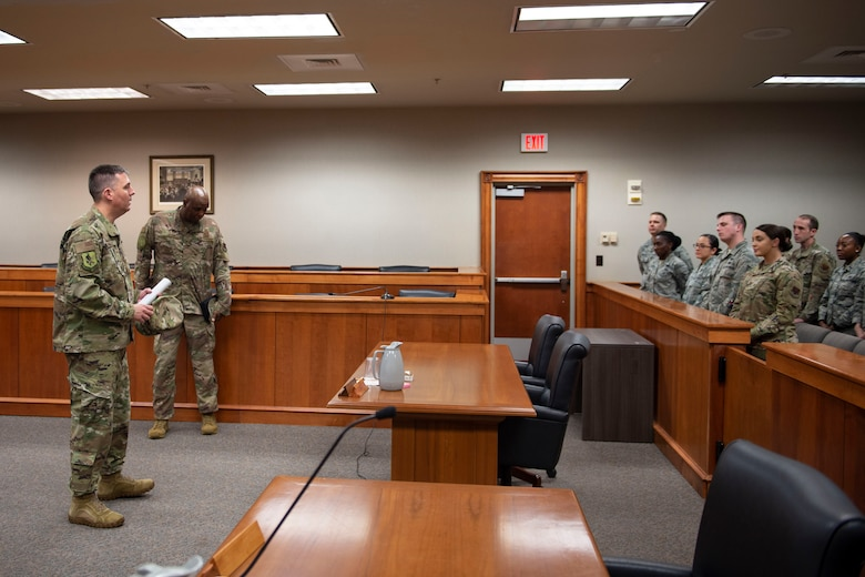 Col. Daniel Walls, 23d Wing commander, visits with Airmen from the Judge Advocate office Oct. 7, 2019, at Moody Air Force Base, Ga. Walls toured different components of Moody's Wing Staff Agency to acknowledge their contributions to the mission. (U.S. Air Force photo by Airman Azaria E. Foster)