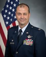 Commander Bio Photo