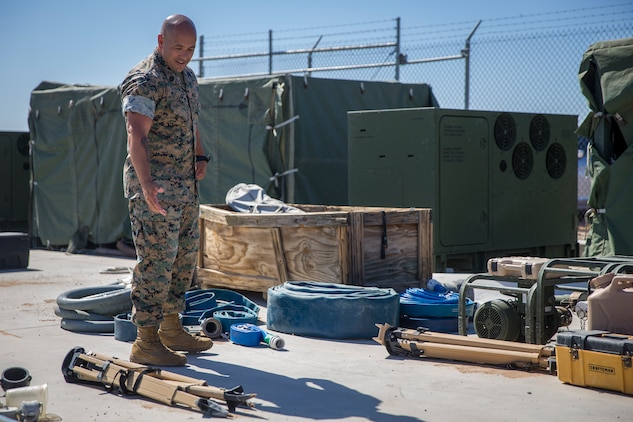 U.S. Marine Corps GySgt Joseph Chinea, the Utilities Chief for Utilities Platoon, Engineer Operation Company, Marine Wing Support Squadron (MWSS) 371, checks over equipment on Canon Air Defense Complex Yuma, Az., Oct 3, 2019. As the Utilities Chief, GySgt Chinea is the technical advisors to the commander on the employment of utilities support in order to analyze, translate, and execute the commanders operational requirements into a utilities support reality that enhances mission accomplishment. (U.S. Marine Corps photo by Lance Cpl. John Hall)
