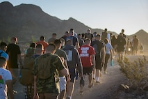 U.S. Marines with Headquarters and Headquarters Squadron (H&HS), Marine Corps Air Staiton Yuma participate in a hike up Telegraph Pass as a part of Operation Future Marine Leaders (FML) in Yuma, Ariz., Oct 4, 2019. FML consisted of the Commanding Officer and SgtMaj of H&HS hiking with the junior Marines up Telegraph Pass, conducting a professional military education (PME), and speaking to the junior Marines about becoming leaders. (U.S. Marine Corps photo by Lance Cpl. John Hall)