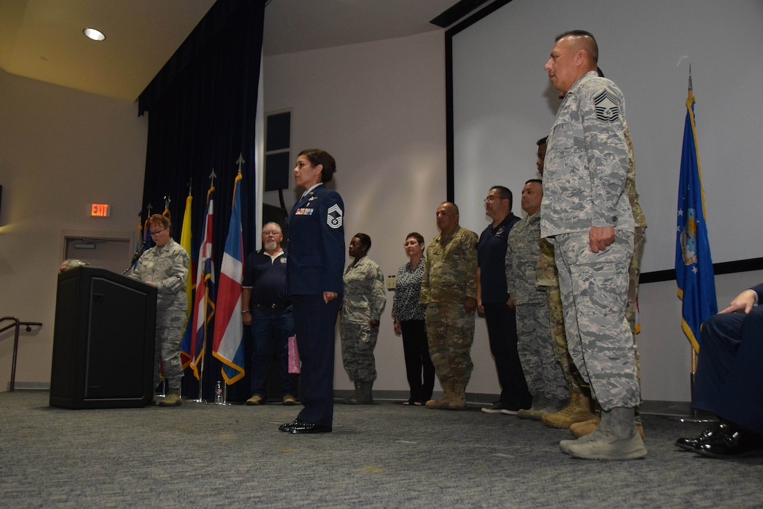 Chief Master Sgt. Shana Cullum, 433rd Airlift Wing command chief, reads the Chief's Creed at the promotion ceremony for Chief Master Sgt. Lisa Lopez, 433rd Medical Squadron superintendent, Oct. 5, 2019 at Joint Base San Antonio-Lackland, Texas.