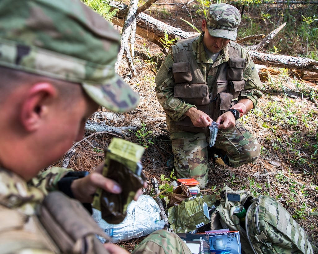 U.S. Air Force Staff Sgt. Randall Moss and U.S. Air Force Master Sgt. William Davis, loadmasters assigned to the 16th Airlift Squadron, sort through survival equipment during a survival, evasion, resistance, and escape exercise August 21, 2019, in North, South Carolina. SERE specialists assigned to the 437th Operations Support Squadron conducted this exercise in order to identify potential areas of improvement in both SERE training and equipment provided to aircrew in case of a potential isolating event. (U.S. Air Force photo/Airman 1st Class Duncan C. Bevan)