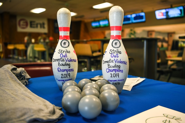 "Master Sgt. Bryan Scroggs, 4th Space Operations Squadron first sergeant, bowls during the Family Advocacy Program's second-annual ""Strike-Out Domestic Violence"" bowling tournament at the Bowling Center on Peterson AFB, Colorado, Oct. 1, 2019. The tournament was a way for family advocacy providers to raise awareness so Airmen can feel more comfortable reaching out if they need their services. (U.S Air Force photo by Katie Calvert)"
