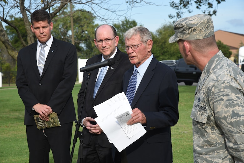 An image of Air Force and Congressional leaders giving a press conference following their review of houses on Tinker Air Force Base.