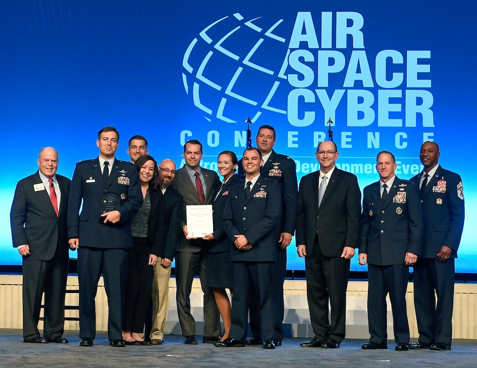 The Kessel Run Team receives the Gen. Larry O. Spencer Innovation Award from Air Force Chief of Staff Gen. David L. Goldfein, Acting Secretary of the Air Force Matthew Donovan, Chief Master Sgt. of the Air Force Kaleth Wright and Whit Peters, Chairman of the Air Force Association Board, during the Air Force Association Air, Space and Cyber Conference in National Harbor, Md., Sept. 16, 2019.(U.S. Air Force photo by Andy Morataya)