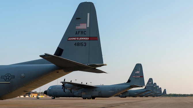 Five 815th Airlift Squadron and two 327th AS C-130J Super Hercules aircraft sit on the flightline at Gulfport Combat Readiness Training Center, Miss. Oct. 1, 2019. The 815th AS, aka 'Flying Jennies,' with the 327th AS, provided airlift and airdrop support for the U.S. Army's Joint Forces Exercise Arctic Anvil, Oct. 1 to 6. (U.S. Air Force video by Tech. Sgt. Christopher Carranza)