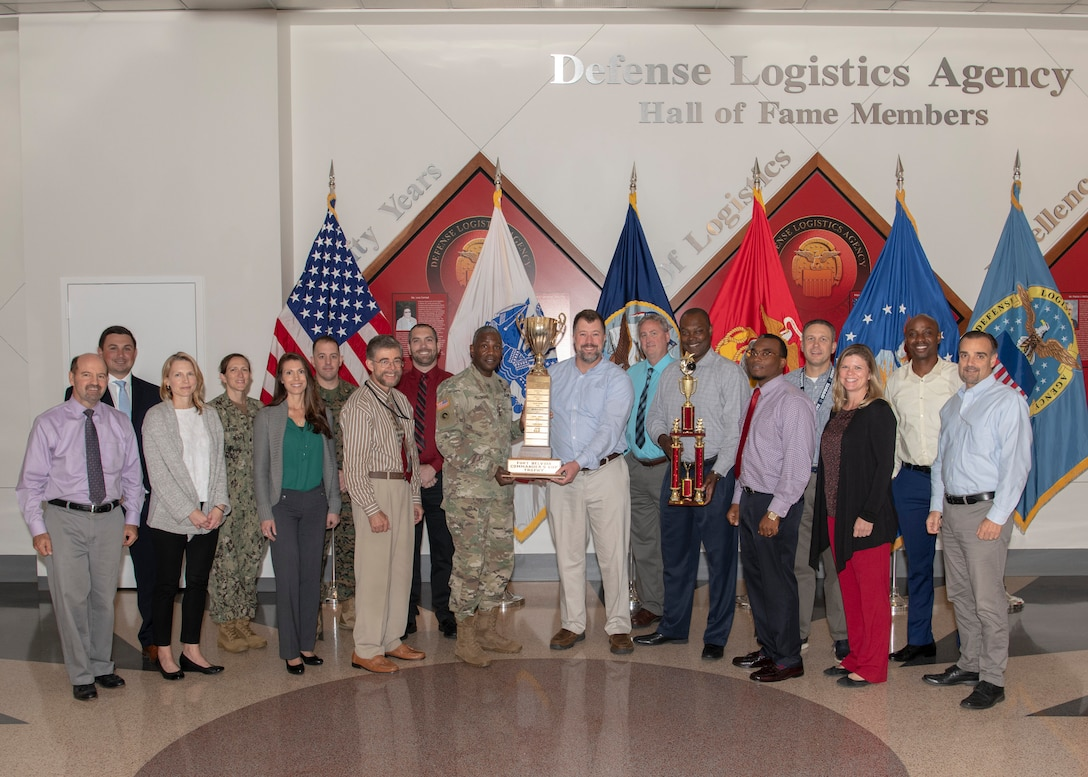 Members of Team DLA, 2019 Fort Belvoir Commander's Cup champions, pose with DLA Director Army Lt. Gen. Darrell Williams (center). Also holding the trophy is Andrew Green of DLA Strategic Materials, who organized DLA's participation in the events throughout the year. This is the second year in a row DLA has won, beating out teams from across Fort Belvoir. Photo by Teodora Mocanu