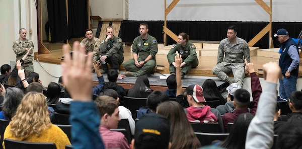Students raise their hands to ask questions of visiting Alaska National Guard members at the Galena Interior Learning Academy Oct. 4, 2019. The Guard members were part of a small team visiting the Yukon River community to provide outreach services to veterans and build relationships for possible future Guard operations.