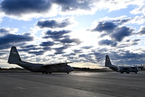 C-130s prepare to take off.