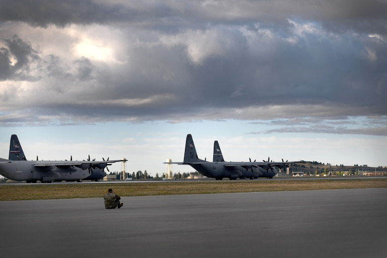 C-130s wait to take off