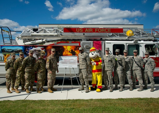 "Members of the 436th Airlift Wing leadership team and the 436th Civil Engineer Squadron fire department pose next to the recently signed proclamation declaring, ""October 6-12, 2019, Fire Prevention Week,"" Oct. 4, 2019, at Dover Air Force Base, Del. This year's theme, ""Not Every Hero Wears a Cape. Plan and Practice Your Escape!"" serves to educate the Dover AFB community about the importance of developing a home fire safety plan. (U.S. Air Force photo by Staff Sgt. Zoe Russell)"