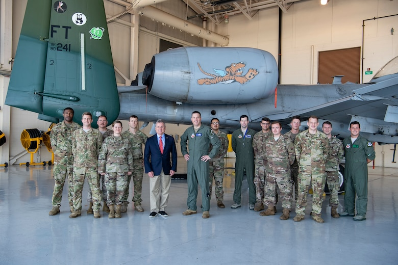 U.S. Representative Buddy Carter, Georgia District 1, poses for a photo with Airmen in front of the 23d Wing A-10C Thunderbolt II flagship at Moody Air Force Base, Ga., Oct. 3, 2019. During his visit, Congressman Carter met Flying Tiger Airmen to learn about their contributions to the 23d Wing mission. (U.S. Air Force photo by Andrea Jenkins)