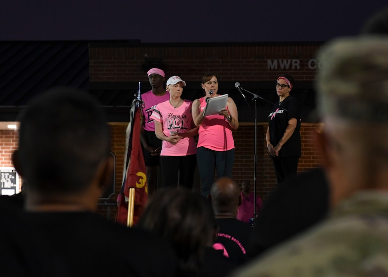 Christine Stiefel, Army Community Service school liaison, speaks during a Breast Cancer Awareness 5K run at Joint Base Langley-Eustis, Virginia, Oct. 4, 2019.